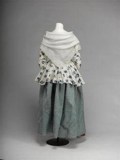 Rear view, caraco jacket and skirt, 18th century. Caraco: White linnen block printed with bliue flower sprays; skirt: blue quilted silk satin.