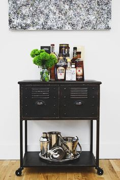 """9 Ways to Make All Your Clutter Look Gorgeous Without Throwing Anything Out: MAKE IT PRETTY. Keep items neat and orderly but still interesting to look at. """"I like adding sculptural objects like small pottery or brass sculpture,"""" says Soria. Putting artwork and fresh flowers nearby makes your booze look fancy, even if it's $7 chardonnay."""