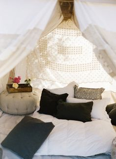 Glamping.  It looks like the tent was made from old table clothes.  I bet I could get some at Goodwill for a good price.  I even think I have some of the poles I could use with it!