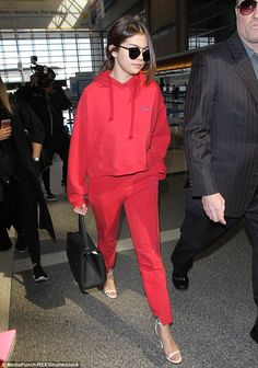 Seeing red! Selena Gomez, 23, stood out from the crowd in bright crimson sweats at LAX air...