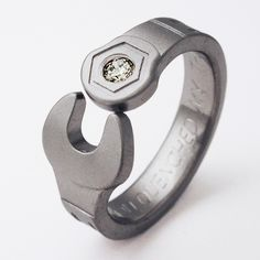 titanium wrench ring... now these would make cool wedding bands!