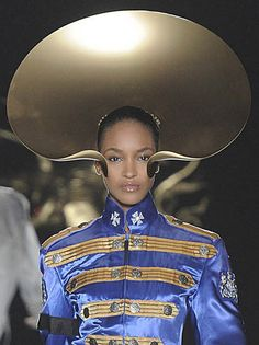 Philip Treacy London. A similar shape to the collar but worn on the head. Some variation of this may be possible with card and ribbon.