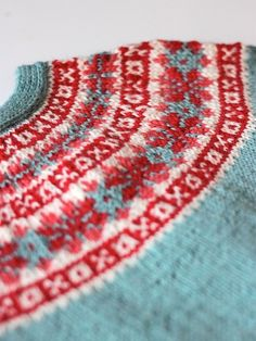 "thejitteryknitter: ""jolinecentrois: "" fibrearts:Red and Blue by handepande "" I love fair isle yokes. So lovely! """
