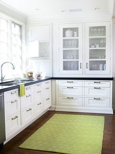 Utilize Lost Space -  This kitchen's combination includes a daily-use appliance garage, additional higher-up spaces for vases/serveware and China cabinet with drawers for placemats, napkins, etc..