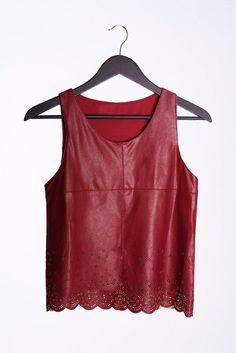 Color: Burgundy Size: Small, Medium, Large Product Detail +Burgundy faux leather tank top +Flower motive laser cut detailing with scalloped hem +Fully lined Attention +55% Cotton, 45% PU +Hand wash co