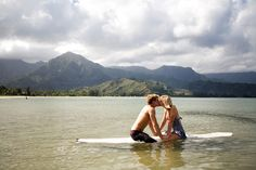 adorable engagement photo.  mountains= our new home.  surf board= our old home