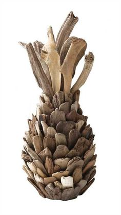 """This Pineapple Decoration will look great on your tablescapes or wedding arrangements. The driftwood gives it a natural and rustic appeal. Artisan Driftwood Pineapple Decor 7-3/4"""" Round x 16-1/2""""H"""