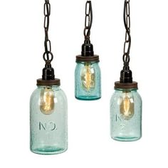 Green tinted bubble glass highlights the mason jar shape which is accented with numbers. This set of three pendants make a home for the vintage-style Edison bulbs they protect