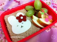 Cute, but simple obento anyone can make. Simple cheese sandwich with fruit. Still nicer than crammed into plastic baggies. Cookie cutters are an obento-maker's best friend.