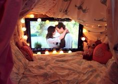 How cute is this cozy den? Create a fortress of duvets and fairy lights for a romantic night in. How cute is this cozy den? Create a fortress of duvets and fairy lights for a romantic night in. Fun Sleepover Ideas, Sleepover Party, Slumber Parties, Kino Party, Indoor Forts, Late Night Movies, Movie Nights, Movie Times, Diy Fort