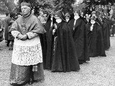 Cardinal Bourne leads in nuns at the ceremony of enclosure at the Convent of the Poor Clares at Aston Hall, Hawarden, Flintshire in May 1932.