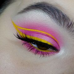 rachelcoffeymakeup: Pink halo eye with a yellow graphic wing...