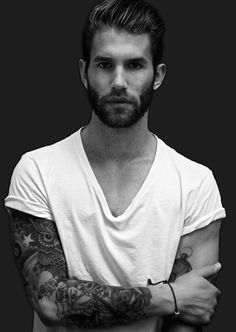 i cant resist a good looking man with a sexy beard in a v neck