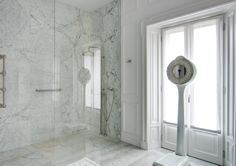 A classy chic apartment in central Milan by Nomade Architettura http://www.nomadearchitettura.com/#all  bathroom, scale, white carrara marble, big shower, carrara sink, plaster frames on wall