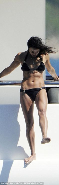 Toned: The star's abdominal muscles make another appearance as she enjoys a quick stretch