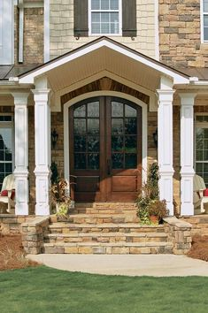 Stone or brick steps leading up to front door and a covered front porch that extends the length of the house. Description from pinterest.com. I searched for this on bing.com/images