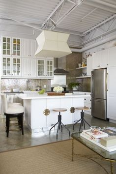 Chose this pic for the island... different, but I like it (not necessarily gold handles).  but the lines are nice and more modern.  Again, there is a mix of traditional and modern in this kitchen - with concrete floors in the den - which I love.