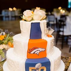 Country Wedding Cakes Unique Super Bowl themed wedding cake featuring the Denver Broncos hidden layer Country Wedding Cakes, Themed Wedding Cakes, Cool Wedding Cakes, Wedding Cake Designs, Themed Cakes, Themed Weddings, Rugby Wedding, Football Wedding, Gorgeous Cakes