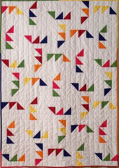 Confetti Maze - crib sized version of Triangle Maze.  http://www.etsy.com/listing/88189582/triangle-maze-quilt-pattern