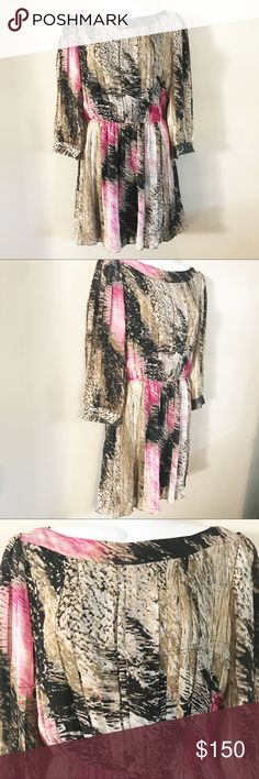 DVF black, tan and pink dress Great condition. Beautiful Diane von Furstenburg dress has sheer long sleeve and is made of 100% silk. Size 6 but would fit a 4 or 6 Diane Von Furstenberg Dresses
