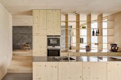 Kitchen in a home in Schwarzenberg, Austria designed by Architekten Innauer Matt