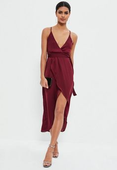 Say it loud in this burgundy dress - featuring a midaxi length, slinky finish and an asymmetric wrap style with plunge neck, this dress will seriously do the talking.