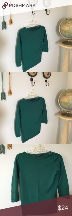 Christmas Green sweater by The Limited Hard to get a pic that shows true color on this one. A beautiful Emerald Green perfect for the Christmas season. 3/4 sleeves with ruching.  Worn once ! Gorgeous The Limited Sweaters Crew & Scoop Necks