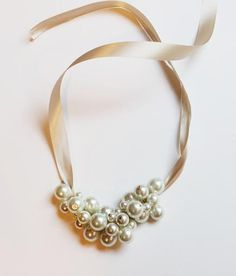 Learn to make a DIY pearl cluster necklace that is versatile, classy and feminine with these simple instructions.