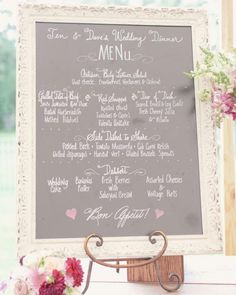 Hearts in pastel pink decorated this calligraphed chalkboard menu at the Connecticut celebration for Jennifer and David.