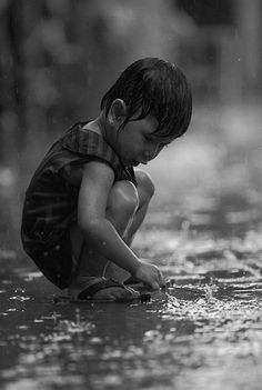Simple pleasures playing in the rain