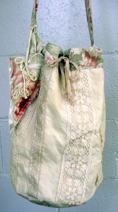 French shopper - lots of old linens and lace. Heart on the side.