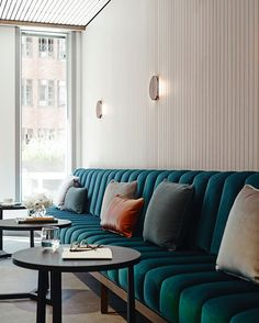 teal tufted banquette with throw pillows. / sfgirlbybay