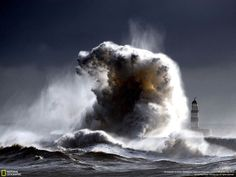 Monster Wave: A raging sea dwarfs Seaham Lighthouse in County Durham in England, with 100ft waves after a cold front moved down from the north bringing freezing temperatures to the North of England. credit: owen humphreys
