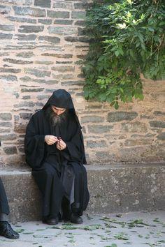Orthodox monk making a komboskini (prayer rope)