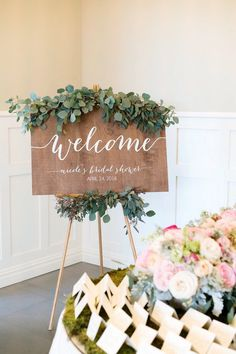 greenery and wooden welcome sign for bridal shower
