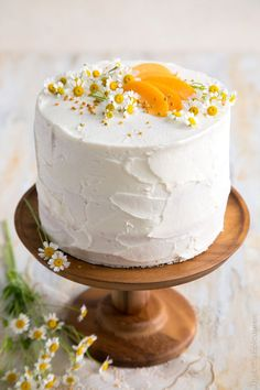 This apricot chamomile cake features three layers of white cake, thin layers of apricot preserves, and a light coating of sweet chamomile buttercream.