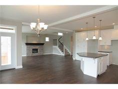Love this! Dark floors, gray walls, white cabinets & trim