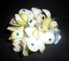 All Seasons Floral- Wrist corsage with white orchids and blue accents