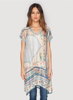 Kobi Long Tunic The Johnny Was Collection KOBI LONG TUNIC is adorned by a vintage-inspired print that combines Folk Art florals with geometric motifs in a feminine color palette of yellow, pink, and green. This printed silk tunic top can be worn over leggings or pants now, and with a silk slip as a tunic dress once the weather warms up!  - 100% Silk - Scoop Neckline, Short Sleeves, Flared Hem - Signature Silk Print: Johnny Was Exclusive - Care Instructions: Dry Clean Only