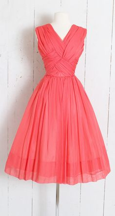 Stunning dress by Carol Robins. Beautiful coral pink chiffon with flattering drape at bodice, v-neckine, acetate and tulle linings, metal back zipper. Vintage Dresses For Teens, Vintage 1950s Dresses, Vintage Style Outfits, 1950s Fashion Dresses, Chifon Dress, Vintage Fashion 1950s, Chiffon, Coral Dress, 15 Dresses