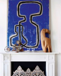Primal and ornate meet on a mantel in London, as seen in Malene Birger's new book, Move and Work (teNeues) | Lonny.com