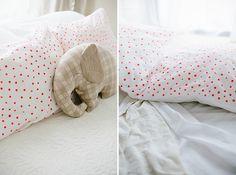 make your own polka dot pillowcases via sayyestohoboken.