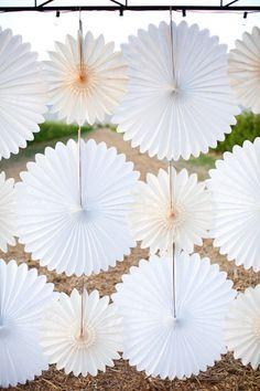 paper pinwheels make for an easy dessert table backdrop