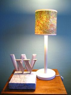 Map lamp shade...we all have some old road maps...great way to reuse! http://chezlarsson.typepad.com/myblog/2008/11/im-so-glad-you-are-going-to-do-a-post-on-the-map-lamp-i-also-like-the-two-lamps-after-the-map-lamp-do-you-do-something-to-m.html