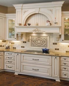 Gorgeous cabinetry! Love the range hood and all the details. Love the backsplash!!