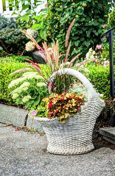 Beautiful Flowers in a Basket (c)2014 Laura Duhaime Duhaime   This was such a nice way to decorate a home entrance way. The stoneware basket was an elegant touch. It was a great planter and could hold a variety of flowers and plants.