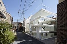 "S-house-designed-by-Yuusuke-Karasawa. ""S"" House has been designed from a computer-generated algorithm that optimizes living space while using a series of zig-zagging staircases. The diagonal lines created by the intersecting stairs provide a seismic resistance against earthquakes. Steel and glass make up the structural facade which visually contradict the other humble neighboring residences. http://www.selectism.com/2014/08/08/see-the-algorithmic-house/"