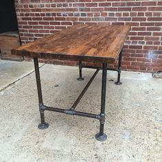Reclaimed pipe and butcher block table from Off the Beaten Track Warehouse