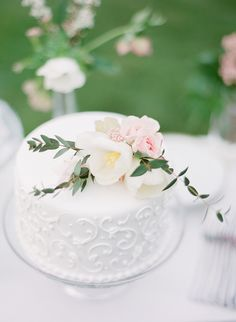 Pretty spring wedding cake: http://www.stylemepretty.com/2016/05/02/spring-into-wedding-season-with-this-inspiration/ | Photography: Julie Paisley - http://juliepaisley.com/