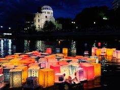 Beautiful colors. Photo: Hiroshima, Japan: Paper lanterns float in the Motoyasu river in front of the Atomic Bomb Dome on the 66th anniversary of the nuclear strike